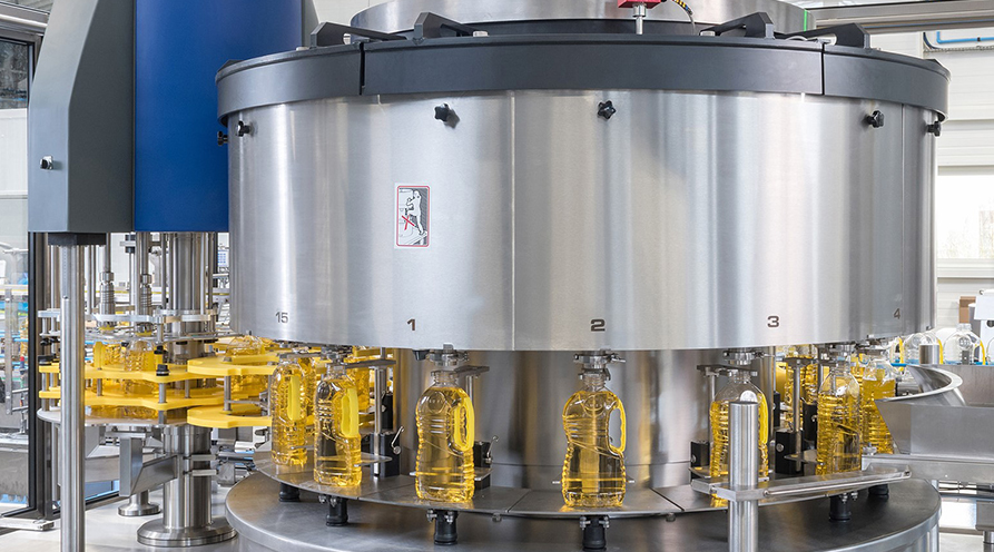 EDIBLE OIL – Filler with bottom transfer of the container and capper– RB